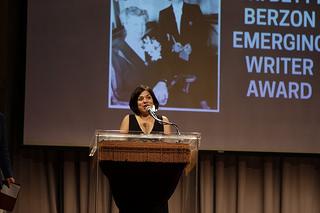 Daisy Hernández, accepting an emerging writer award. Via lambdaliteraary.org